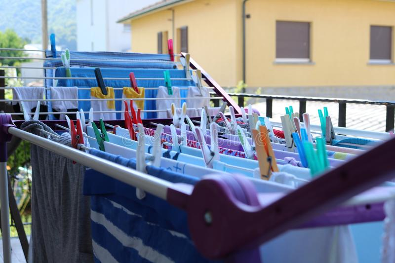 Hanging clothes on drying rack on a balcony royalty free stock images