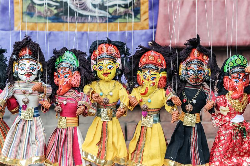 Hanging colorful Nepalese Puppet Dolls stock image