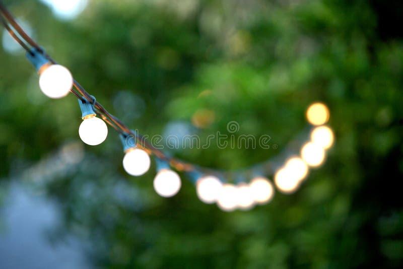 Hanging decorative christmas lights stock photography