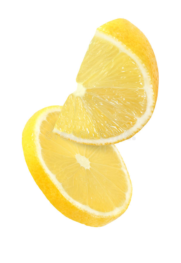 Hanging, falling and flying piece of lemon fruits isolated royalty free stock photography