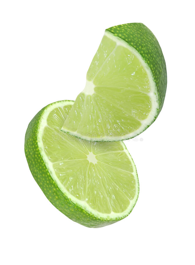 Hanging, falling and flying piece of lime fruits isolated royalty free stock photography