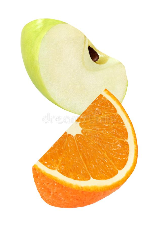 hanging, falling and flying piece of orange and apple slices fruits isolated on white background with clipping path stock photography