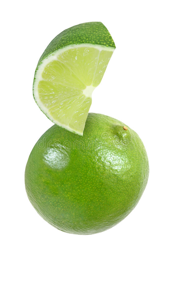 Hanging, falling, hovering, flying piece of lime fruits isolated. On white background with clipping path stock image