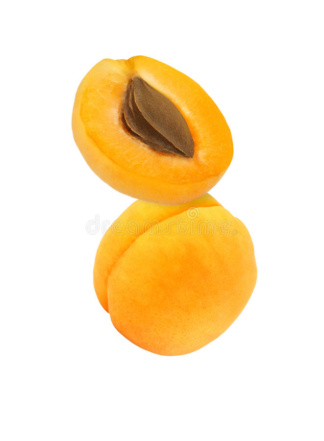 Hanging, falling, hovering and flying whole and sliced apricot stock photography