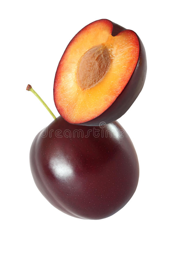 Hanging, falling, hovering and flying whole and sliced plum. Isolated on white background with clipping path royalty free stock images