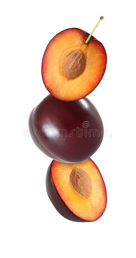 Hanging, falling, soaring and flying whole and sliced plum royalty free stock photo