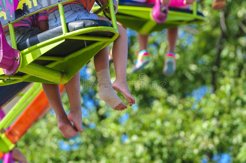 Hanging feet stock images
