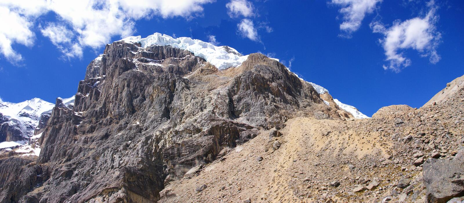 Hanging glaciers on steep rocky mountain, royalty free stock photography