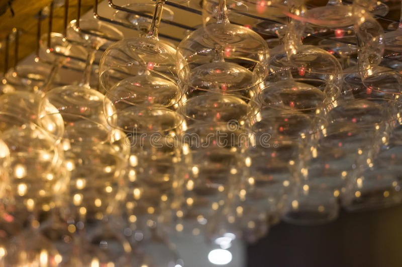 Hanging glasses above a bar royalty free stock images