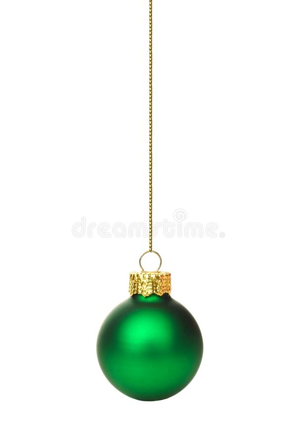 Hanging green Christmas ornament over white royalty free stock photography
