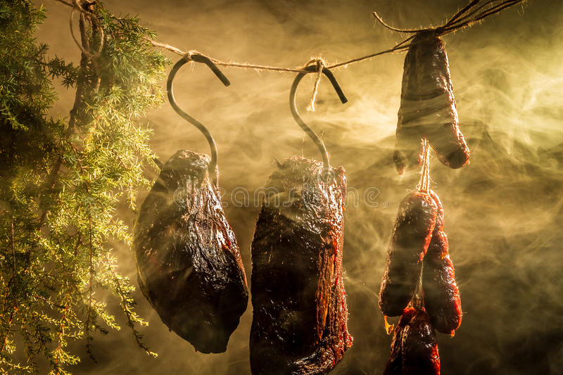 Hanging ham in the smokehouse stock photos