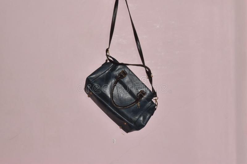 HANGING HAND BAG ON THE WALL stock photos