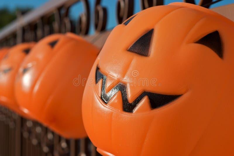 Hanging Jack-o-lanterns as Halloween Luminaries stock photography