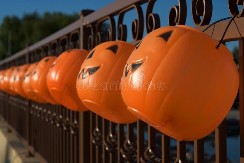Hanging Jack-o-lanterns as Halloween Luminaries stock images