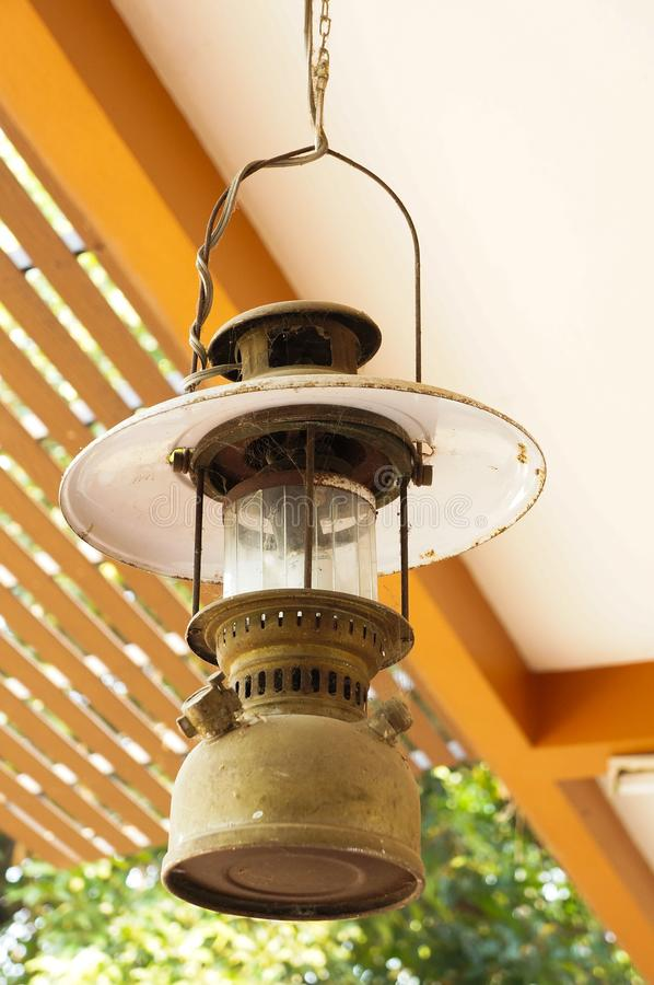 An hanging lamp. An old suspended metallic lantern stock images