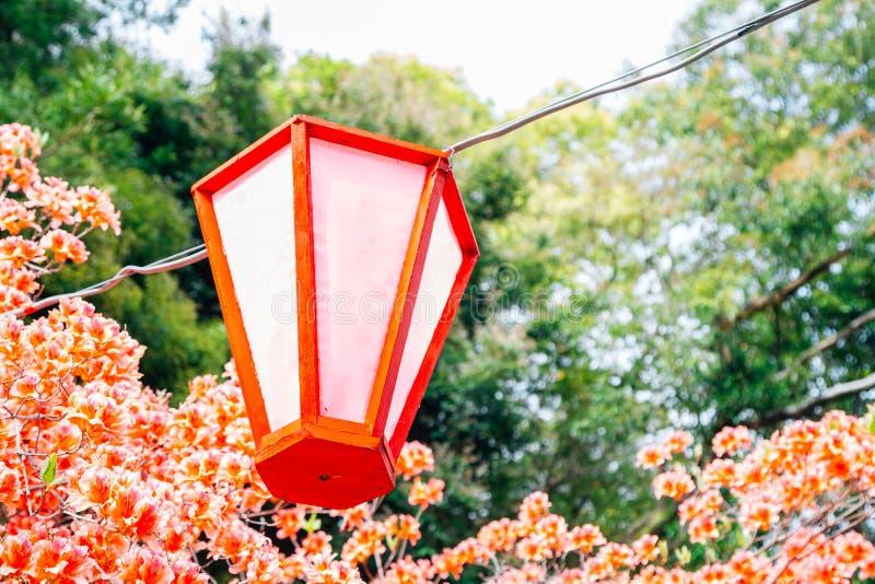 Hanging lantern with spring flowers at Kochi Castle park in Kochi, Japan. Hanging lantern with spring flowers at Kochi Castle park in Kochi, Shikoku, Japan stock photo