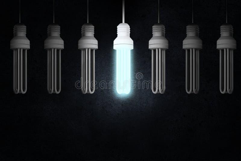 Hanging light bulb. Illuminating hanging light bulb on dark background stock images