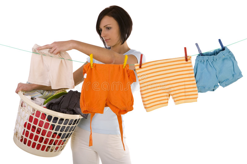 Hanging out washing on a clothesline stock images
