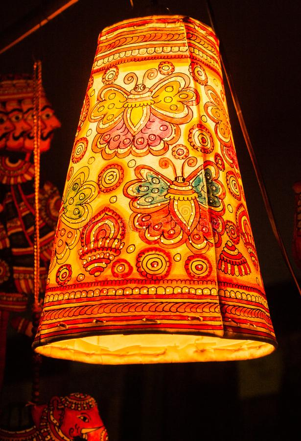 Hanging Painted Paper Lamp. Hanging Paper lamp, butterfly and geomatric pattern painted on it royalty free stock image