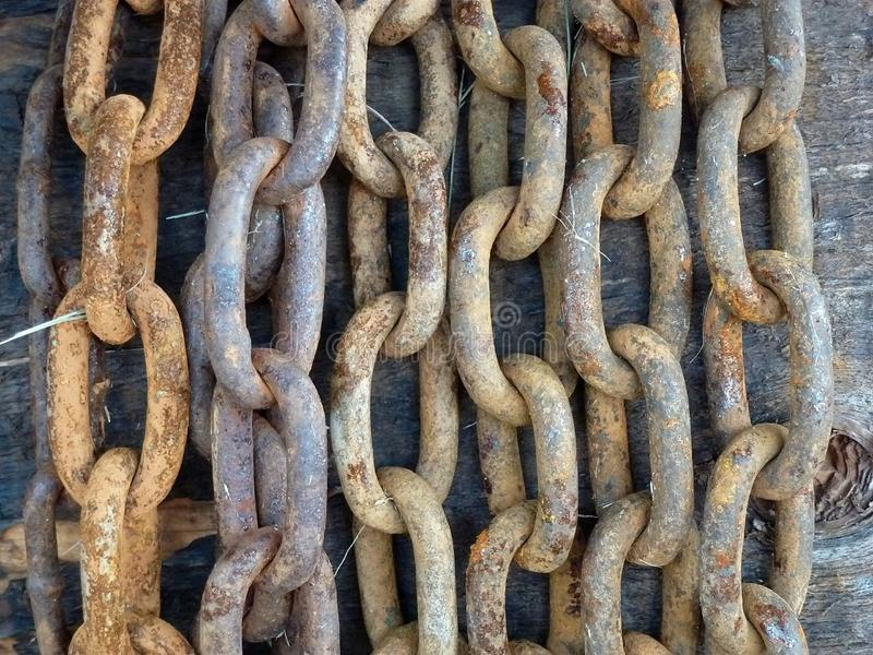 Hanging rows of rusted chain with large links. Chain-a product, a structure consisting of the same rigid parts, called links in the original meaning — royalty free stock image