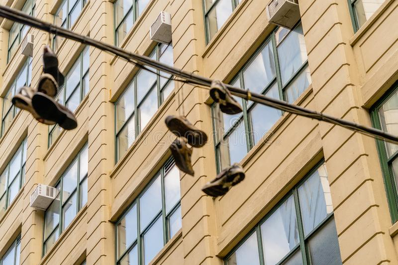 Hanging shoes in Dumbo, Brooklyn. New York USA stock photos