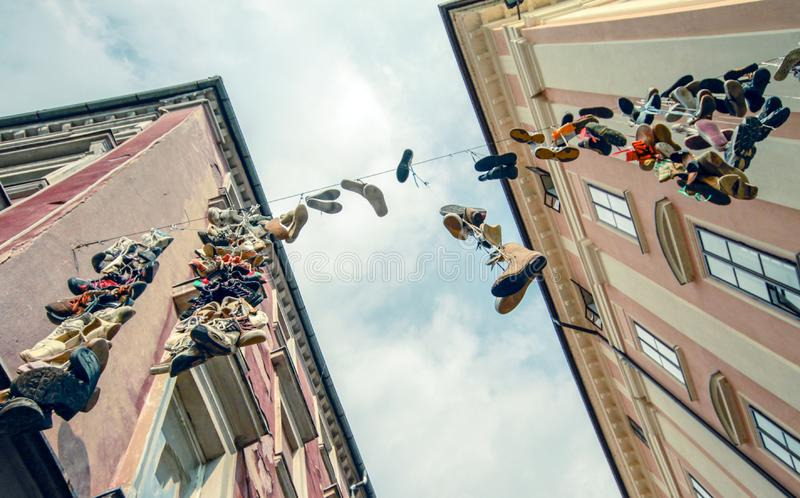 Hanging shoes urban image. Looking up stock image