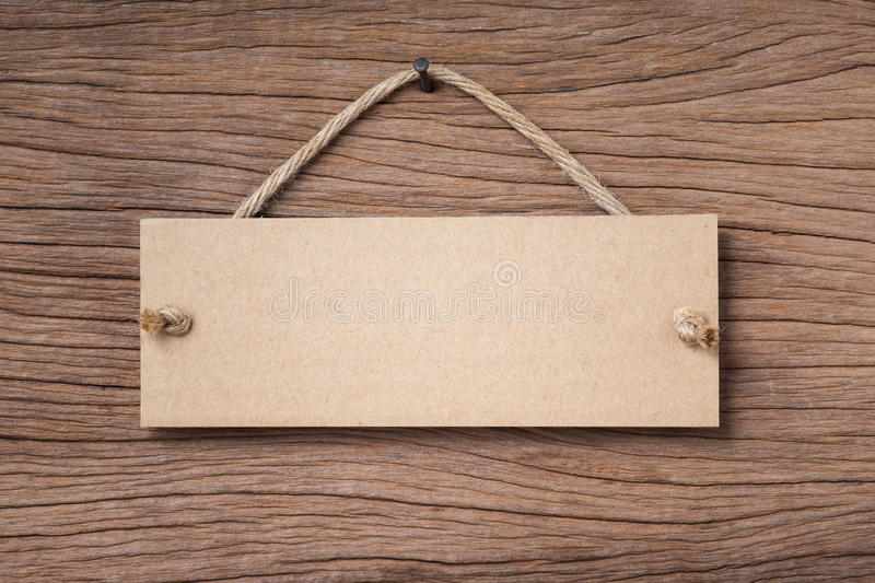 Hanging signboard. Blank signboard hanging on old wood stock image