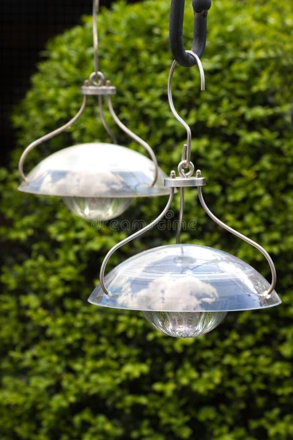 Hanging solar lamps to illuminate garden stock image for Iluminacion solar jardin