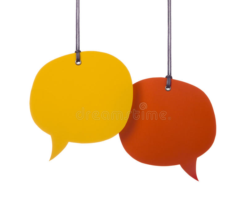 Hanging Speech Bubbles. Hanging two colorful speech bubbles royalty free stock photo