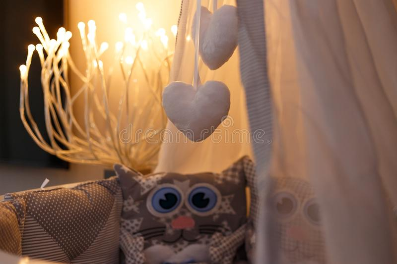 Hanging toys in a baby cot in the shape of a heart royalty free stock image
