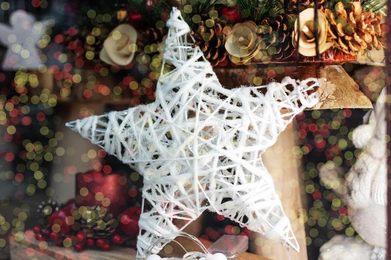 Hanging whit wooden christmas snowflake toy. Beautiful Christmas decoration stock photo