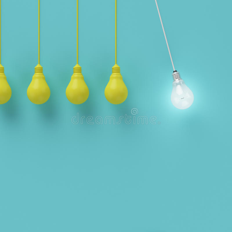 Hanging yellow light bulbs with glowing one different idea on light blue background stock images