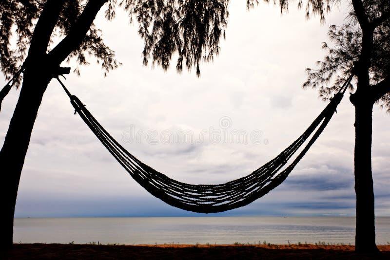 Hangmat op strand stock foto's