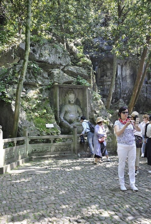 Hangzhou, derde kan: De gesneden standbeelden van Boedha steen van de grotten van Feilai Feng in Hangzhou royalty-vrije stock foto's