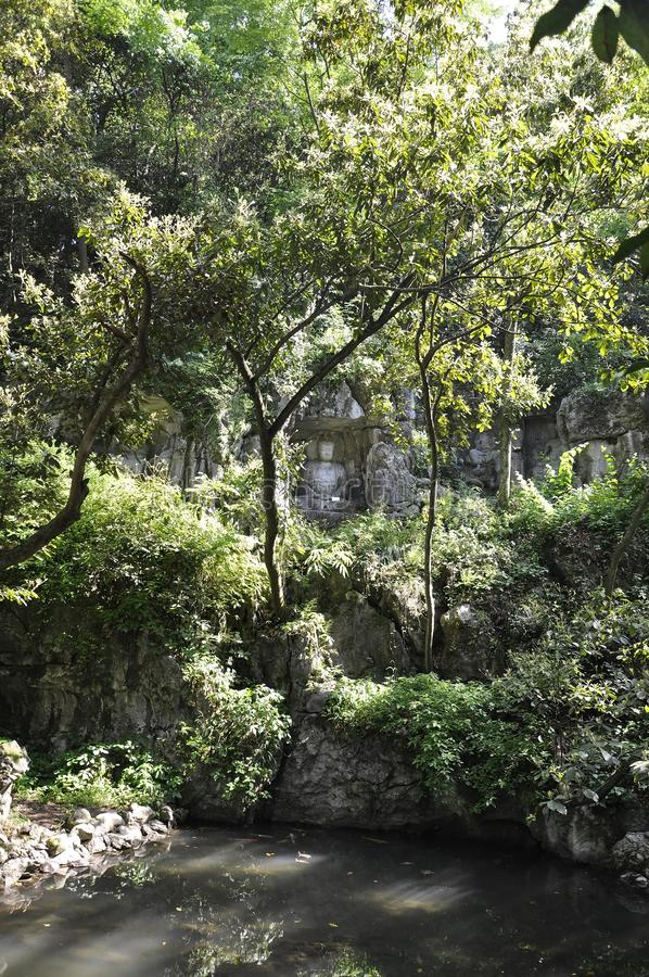 Hangzhou, derde kan: De gesneden standbeelden van Boedha steen van de grotten van Feilai Feng in Hangzhou royalty-vrije stock afbeelding