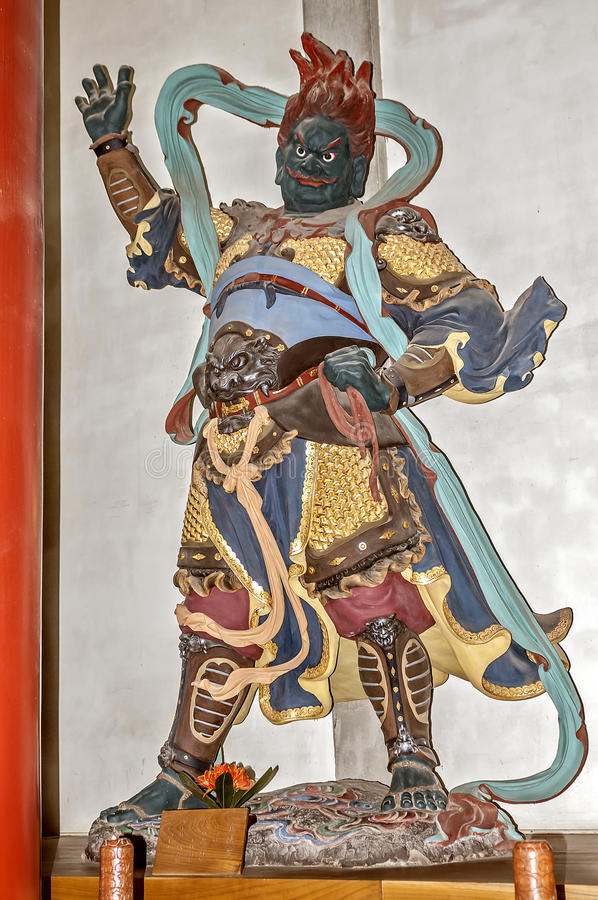 Hangzhou. Sculptural figure personifying the Guardians of the Zodiac. China, Hangzhou. Hall of Heavenly Rulers - one of the most important rooms in the Buddhist stock image