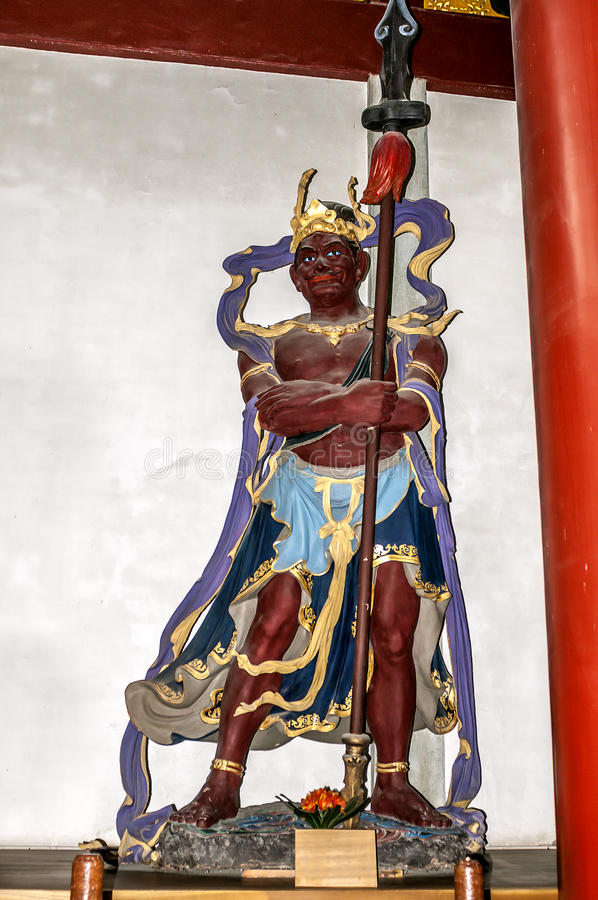 Hangzhou. Sculptural figure personifying the Guardians of the Zodiac. China, Hangzhou. Hall of Heavenly Rulers - one of the most important rooms in the Buddhist stock photos