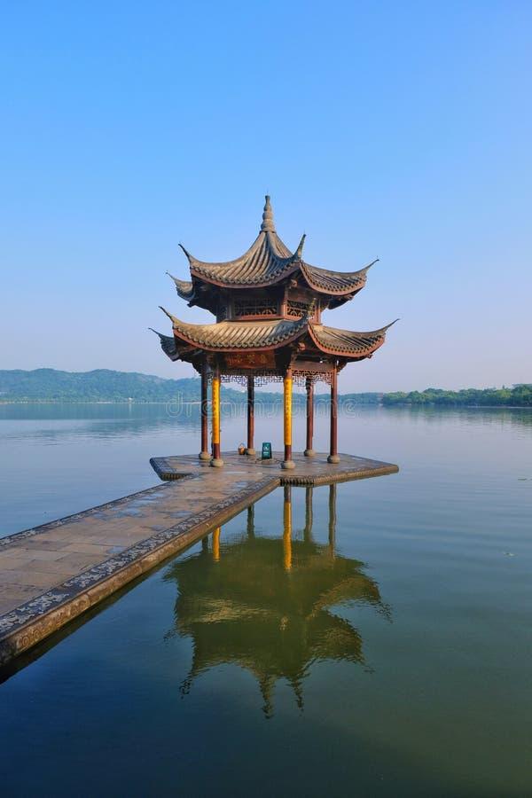 Hangzhou West Lake, Zhejiang, China 杭州. Early morning walk along the touristy Hangzhou West Lake royalty free stock photos