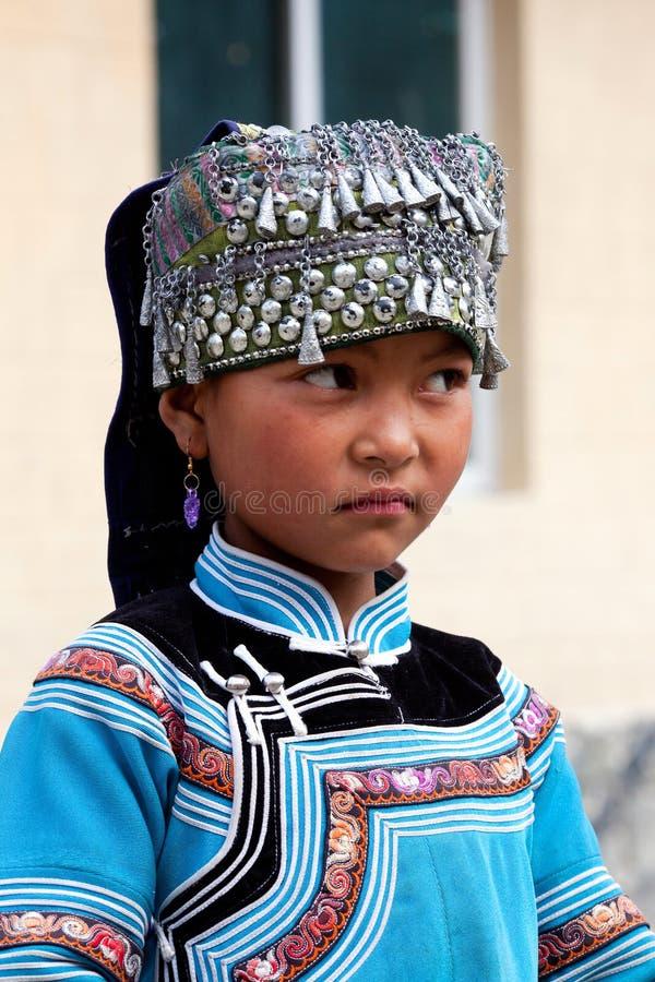 Hani people, China. YUANYANG, CHINA - MAY 05: Hani shoolgirl poses for a photo during Yuanyang festival on May 05, 2014 in Yuanyang, China stock images