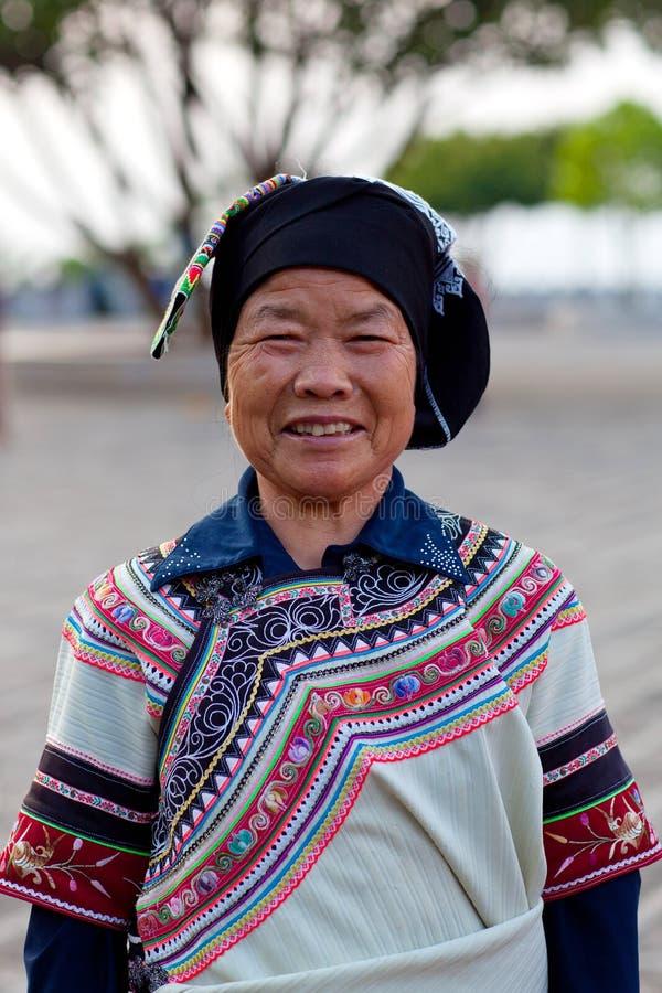 Hani woman, China. YUANYANG, CHINA - MAY 04: Unidentified Hani woman in national clothes poses for a photo during Yuanyang festival on May 04, 2014 in Yuanyang royalty free stock image