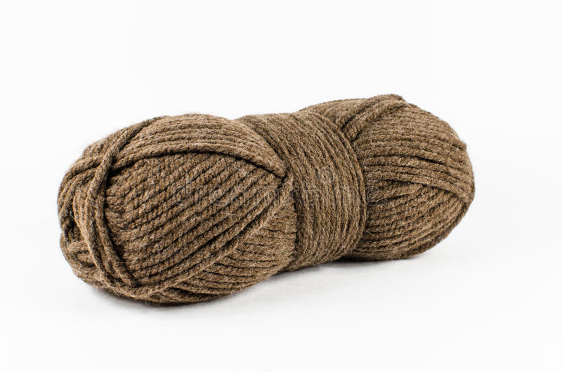 Hank of wool yarn. Hank of brown wool yarn. Isolated on white stock photography