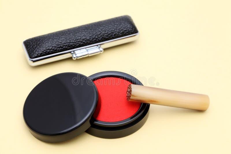 Hanko and ink pad. Close up of Japanese hanko and ink pad stock image