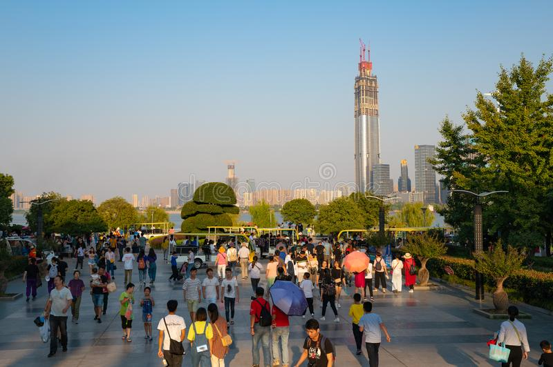 Hankou riverside park entrance with lot of Chinese tourists during golden week and Wuhan skyline in background stock photos