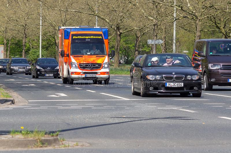 German ambulance drives to a place of employment. HANNOVER / GERMANY - APRIL 18, 2018: German ambulance drives to a place of employment stock photos