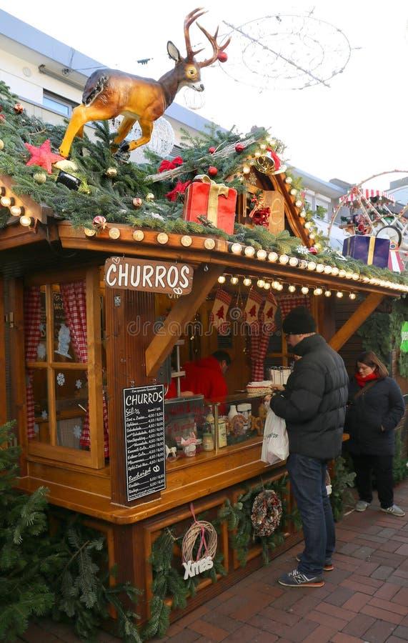 Guy buying Spanish Churros at Christmas Market stock images