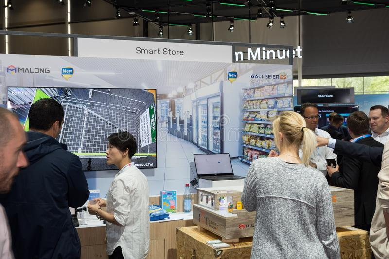 Hannover, Germany - June 13, 2018: Clients and employees. At the booth of the companies Malong and Allgeier Es at CeBIT 2018. CeBIT is the world`s largest trade royalty free stock photo