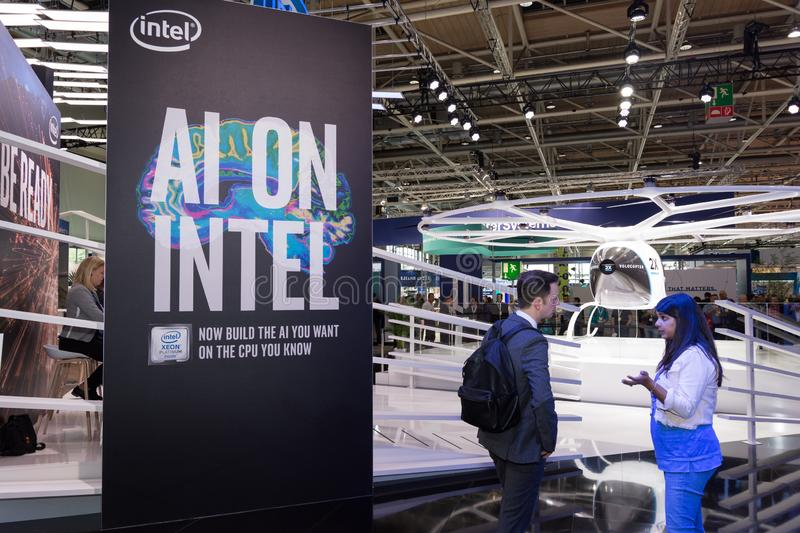 Hannover, Germany - June 13, 2018: Part of the Intel booth. With fair visitors and velocopter in the background at CeBIT 2018. CeBIT is the world`s largest stock image