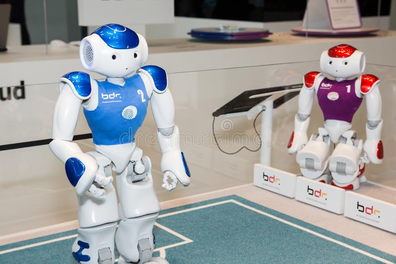 Hannover, Germany - June 13, 2018: Two Nao robots from Softbank. At the booth of the institution Bundesdruckerei at CeBIT 2018. CeBIT is the world`s largest royalty free stock photos