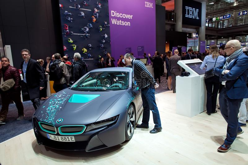 Self-driving BMW i8 Roadster and virtual reality Microsoft HoloLens by IBM company on exhibition fair Cebit 2017 in. Hannover, Germany - March, 2017: Self royalty free stock images