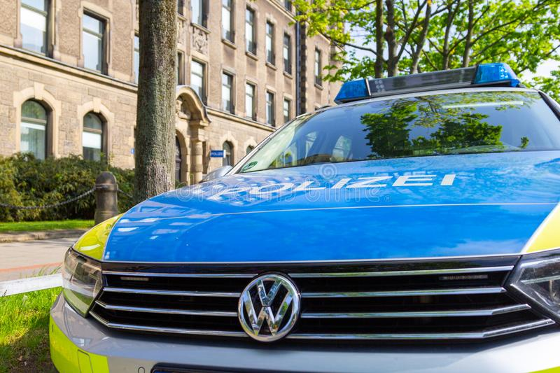 German police car stands in front of a police department stock photos